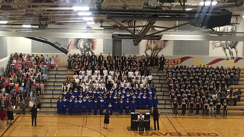 Choirs+come+together+to+sing+%E2%80%9CCelebration%E2%80%9D+as+a+final+song+for+their+audience.+%22The+All+District+Music+Festival+was+great%2C+I+love+seeing+all+of+the+choirs+working+together+to+make+a+great+show%22+said+senior+and+Concert+Choir+member+Stephanie+Wislen.+It+was+a+successful+concert+that+showed+off+the+heaps+of+musical+talent+in+the+Lake+Stevens+School+District.+