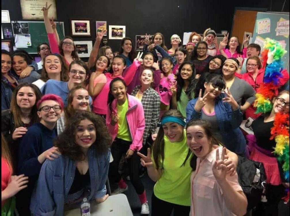 """90's kids transport back into 80's world  The combined choir kids get together for one last picture before the final performance  Choir kids get into character to get the audience into the last song """"Neutron Dance""""  by The Pointer Sisters."""