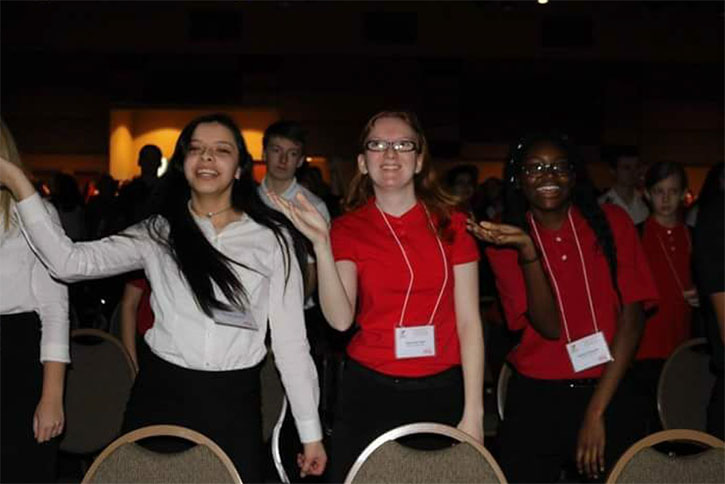 "Juniors Meraiah Medellin, Savannah Pratt, and senior Destiny Otusanya are joining in the FCCLA meeting festivities by showing off their best dance movies. ""My state experience was really great! I really liked the dance,"" junior Savannah Pratt said. Credit to: Hahn's photos"