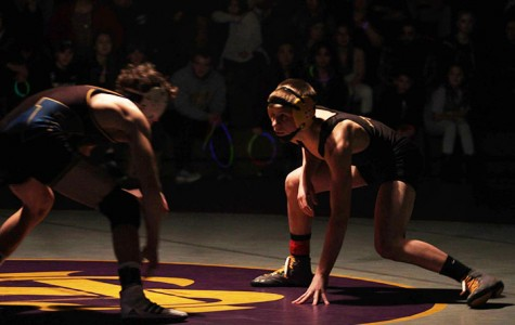 Wrestlers stand strong and practice hard to make their way to State