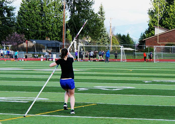 """Sophomore Kendra Otto Von Askervold practices her vaulting runs in preparation for qualifying competitions. Her vaulting performances landed her a spot on the varsity pole vaulting team. """"My goal for next year is to make it all the way to states, and that's going to take a lot of hard work,"""" said Otto Von Askervold."""