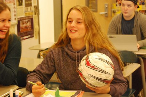 Some athletes like junior Emily Peterson, are able to balance sports with their schoool work.