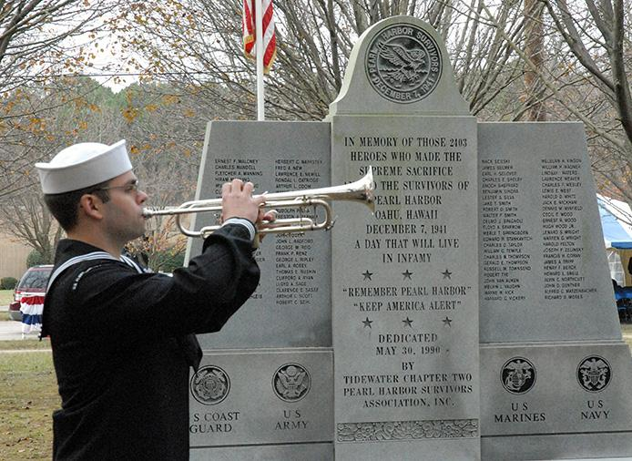LITTLE CREEK, Va. (Dec. 7, 2009) A bugler plays taps during a Pearl Harbor Remembrance Ceremony at Joint Expeditionary Base Little Creek.