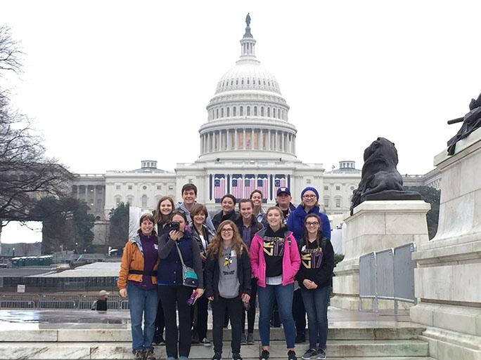 """Here the group stands in front of the Capitol Building (From left to right - Top row: UW student Nick Peda, Mrs. Tilley, Mrs. Wagner, Drew Pearson, Elizabeth Stanton. Middle row: Elise Gooding, Mrs. Kinnard, Paige Wagner. Bottom row: Mrs. Riebli, Mrs. Fry, Jeyda Thomson, Anna Lundquist, Sophie Grieser). The seniors spent five days in Washington, D.C. touring and attending the inauguraton. Even though they grew up with Obama as president, and many of them don't support Trump, they are keeping an open mind about his administration. """"I hope the next four years will look a lot like last Saturday [the Women's March] did, with lots of people coming together to support each other,"""" said senior Elizabeth Stanton. (Photo courtesy Darrick Hayman)"""