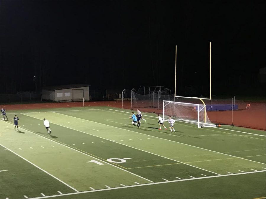 Goalie Jameson Smith catches ball before Kamiak is able to score.