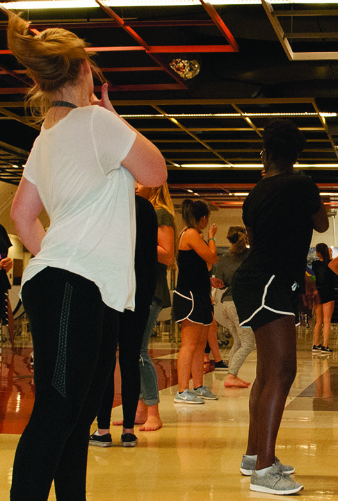 """Senior Kayla Perkins and junior Brenda Hoist practice their routine for the Homecoming Assembly to be held on October 20, 2017. All dance routines have been choreographed by students, the last two were choreographed by senior Makenzie Heggie. """"We are all pretty confident about the new dance routine and excited to perform at the assembly,"""" says Olivia Quattrin."""