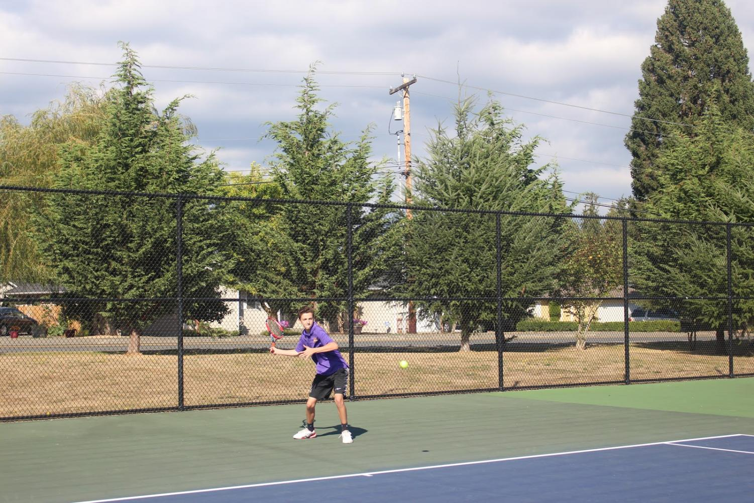COMING AT YOU: One of our great tennis players, practicing for districts, He was with his team, who were also preparing for Districts.