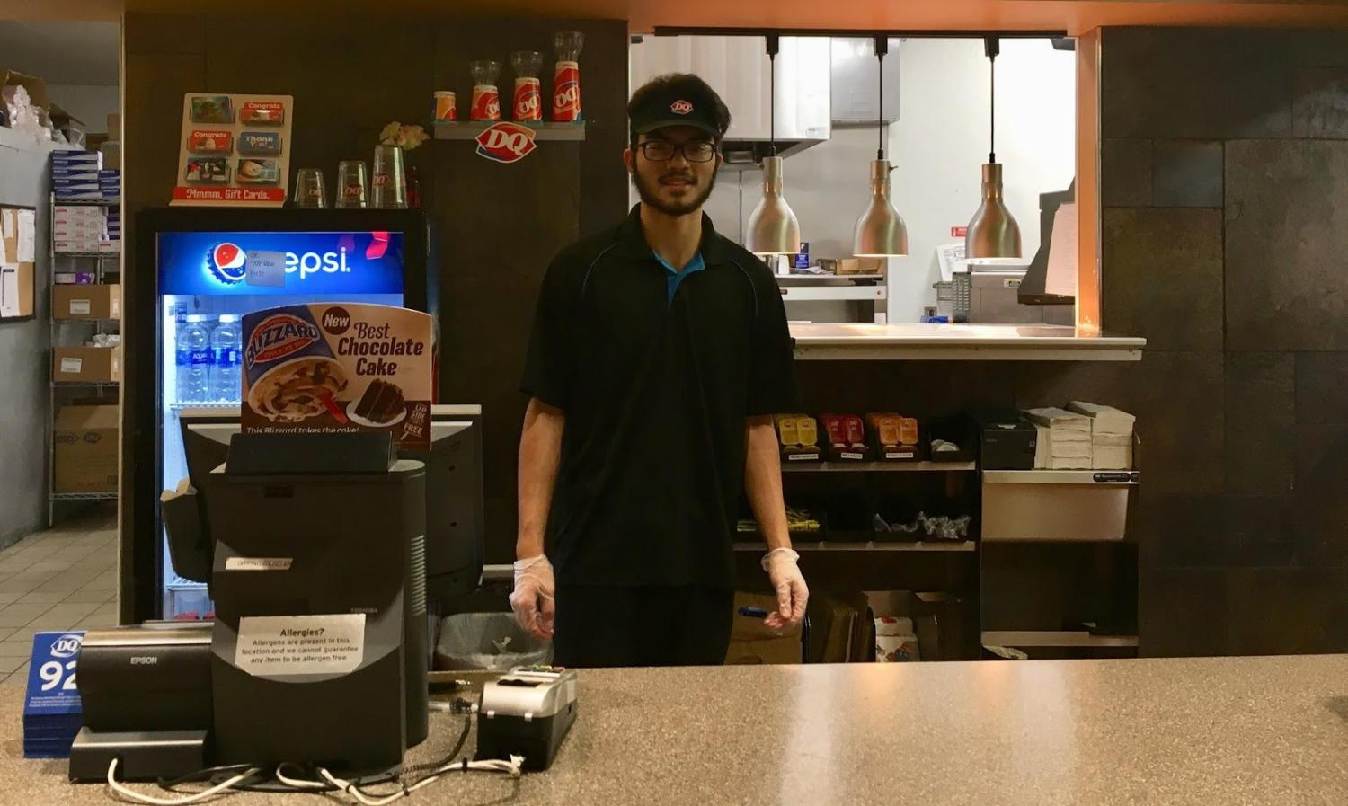 "Serving Food with a Smile: Aaron Moors awaits customers at the Lake Stevens Dairy  Queen. Moors worked at the front counter happily serving others. ""At my job  I clean  machines and grills, prepare food and drinks, clean floors and do dishes at the end of the night,"" Moors said."