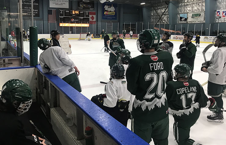 Cold+and+Intense.+As+the+team%2C+Everett+Jr.+Silvertips+18UC+Grizzlies+gathers+around+coach+Joe+Hammond+for+an+explanation+as+to+how+to+run+the+next+drill.+Before+the+team+gathered+once+again%2C+they+worked+on+passing+the+puck+at+certain+angles+at+which+would+help+them+score+at+a+better+rate.+%E2%80%9CThe+season+so+far+has+been+a+good+one+and+has+been+a+lot+of+fun.+The+team+is+full+of+a+wide+range+of+skill+levels%2C+so+it+has+been+exciting+to+see+how+each+individual+performs+on+the+ice+and+give+to+them.+We+are+currently+midway+through+the+season+with+an+upcoming+tournament+in+Bremerton%2C%E2%80%9D+senior+Cameron+Ford+said.+