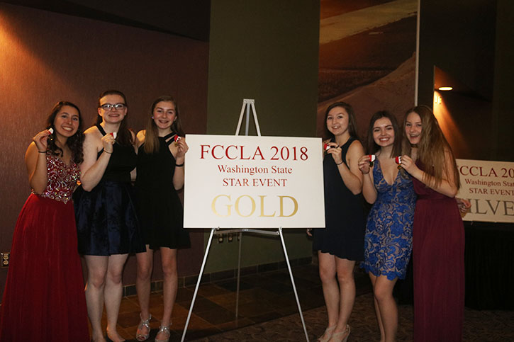 Going+for+the+Gold%3A++From+left+to+right%3A+FCCLA+gold+medalists%2C+junior+Taylor+Garcia%2C+senior+Emma+Hoggatt%2C+sophomores+Courtnay+Yelm+and+Harley+Kayser%2C+juniors+Maleah+Plank+and+Kylea+Shepard%2C+pose+for+a+celebratory+photo+at+the+state+conference+in+Kennewick%2C+Washington.+This+group+advanced+to+nationals+this+summer+in+Georgia.+%E2%80%9C%5BCompeting%5D+is+really+cool.+It%E2%80%99s+a+good+experience+to+have+and+you+gain+a+lot+of+leadership+experience%2C+a+lot+of+skills+that+you+use+when+you+are+an+adult.+You+learn+how+to+communicate+a+lot%2C%E2%80%9D+Plank+said.%0A%0A%0A%0A