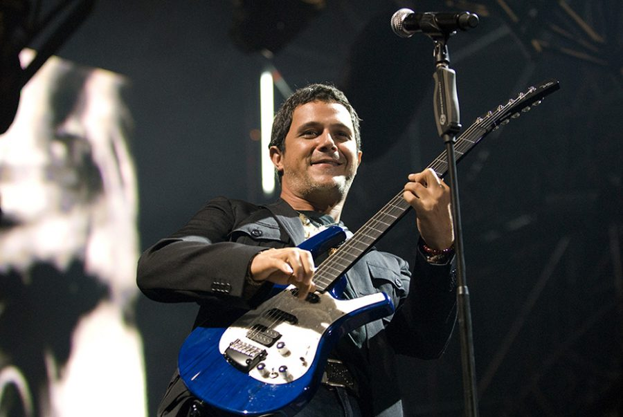 AYAY+CARAMBA%3A+Singer%2C+musician%2C+and+songwriter+Alejandro+Sanz+rocks+his+guitar+during++a+concert.+Sanz+has+produced+12+studio+albums+and+has+been+in+the+Spanish+Album+Charts+various+times.+He+has+also+gotten+many+awards+including+6+Latin+Grammys+Awards+and+an+American+Grammy+Award.%0A