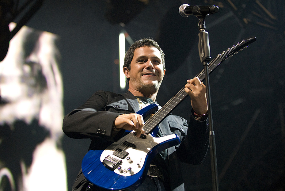 AYAY CARAMBA: Singer, musician, and songwriter Alejandro Sanz rocks his guitar during  a concert. Sanz has produced 12 studio albums and has been in the Spanish Album Charts various times. He has also gotten many awards including 6 Latin Grammys Awards and an American Grammy Award.