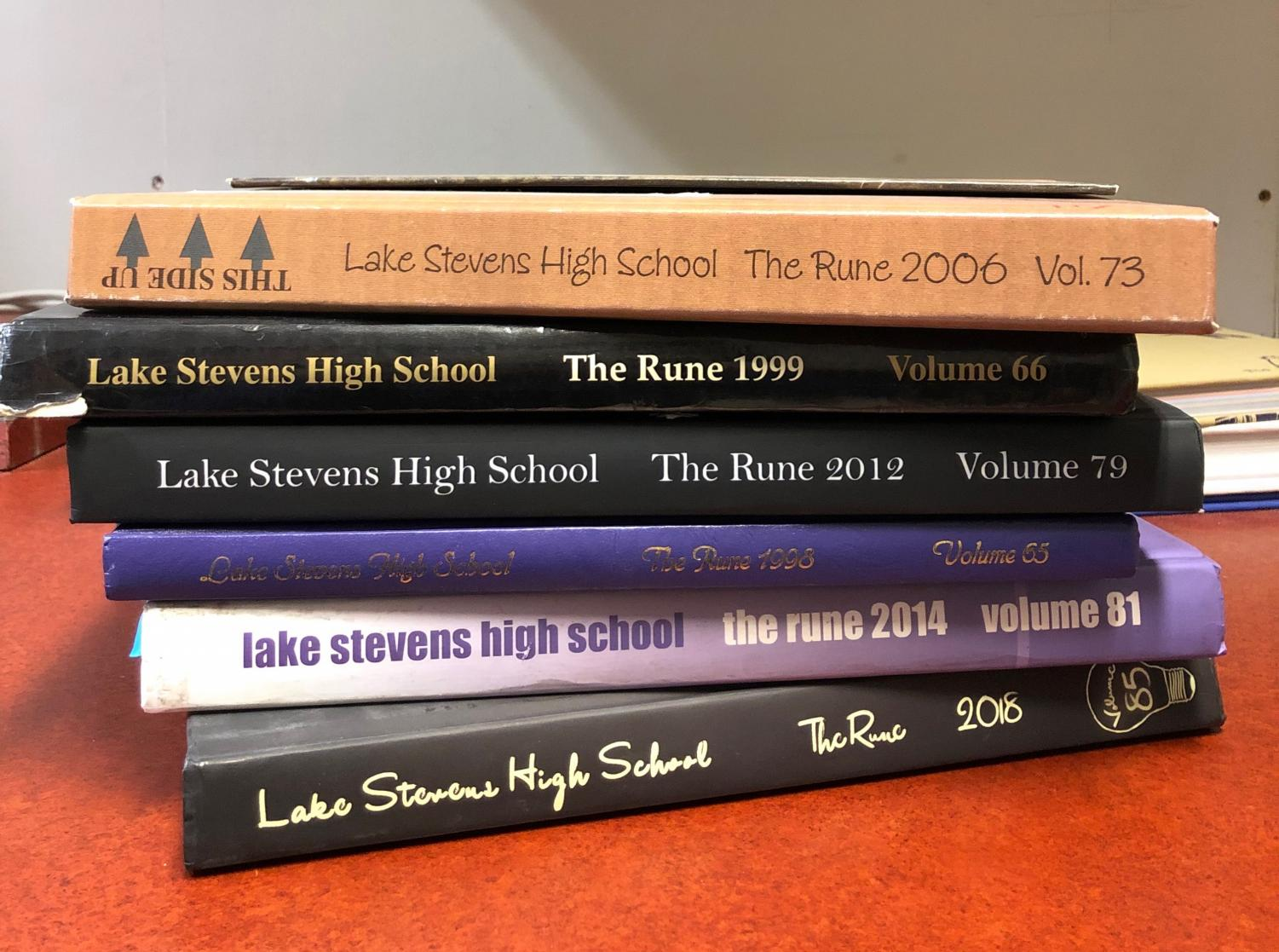 "Six yearbooks from previous years are pictured above. From the years of 2006, 1999, 2012, 1998, 2014, and the most recent from 2018. The yearbook staff of the year 2018-2019 consists of only 10 people. Without the collaboration of the Journalism and Yearbook class, there would have only been four total people in yearbook. As the years go by, fewer and fewer people sign up for the class. ""Without participation by the student body, yearbooks will no longer be available to purchase,"" Copy Editor senior Julia Pinheiro de Oliveira said."