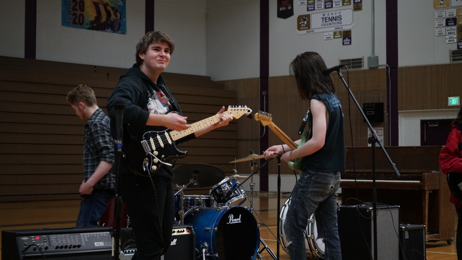"Getting Lost in the Music: Sophomore Taylor McAllister looks  at the crowd, playing alongside sophomores Rory Cannon and Eli Gamage during the annual talent show at the Lake Stevens High School gym on April 17. The group, known as ""Cassie and the Cockroaches"", hope to perform in the near future due to the availability of the band members."
