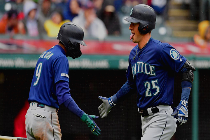 Dylan+Moore+%28RIGHT%2C+%2325%29+receives+a+congratulatory+high-five+from+Dee+Gordon+%28LEFT%2C+%239%29+after+he+hits+a+home-run.+The+Mariners+were+down+3-2+against+the+Cleveland+Indians+and+needed+a+tying+run.%0A