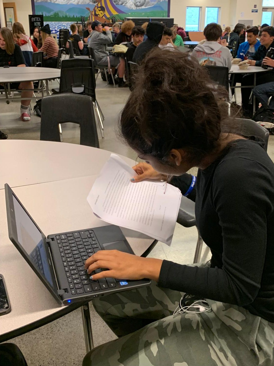 "Sophomore Akilah Degrant reviews her biology notes before going into class. She only had two school days left before her final and wanted to make sure she could get all of her questions answered. ""Finals are really important to me, I want to do good on them,"" Degrant said."