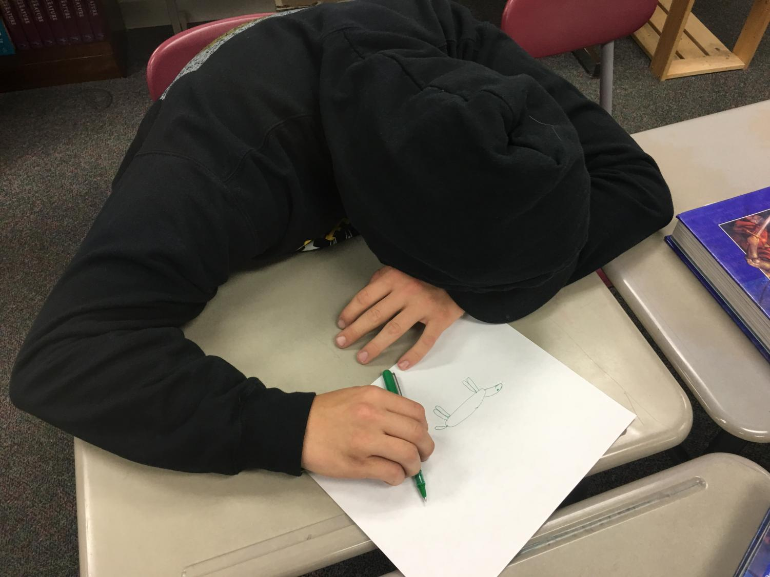 LSHS senior suffers from the late stages of senioritis. The coffee has worn off and has left the student helpless, unable to find motivation in his final days of high school.