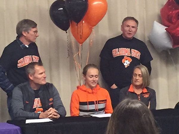 Orange you glad to go to college?: Senior Taylor Roe prepares to sign her letter of intent to Oklahoma State University to compete in their Cross Country and Track and Field programs starting next season. Ever since she transferred here from Kamiak High School during her sophomore year, she has led both the Cross Country and Track and Field programs to prominent success, which got the attention of numerous universities from around the country. Taylor is one of eight seniors interviewed for this piece that have signed their letter of intent to play college athletics next season.