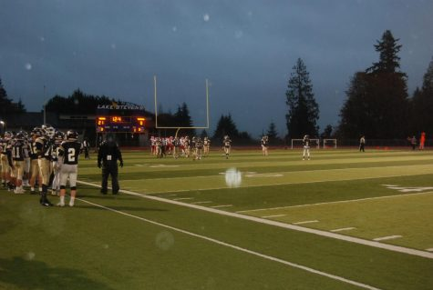 "Always improving: The lake stevens football team spends their hours       after school practicing, rain or shine. This picture shows a scrimmage        during a rainy day. ""Everyday after school we are doing something""        -Austyn Rembold-Hyde."