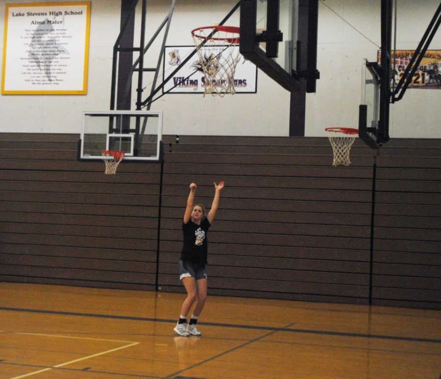 Perfect swish: Amila Wilcox working hard in warmups and getting ready for girls basketball tryouts.