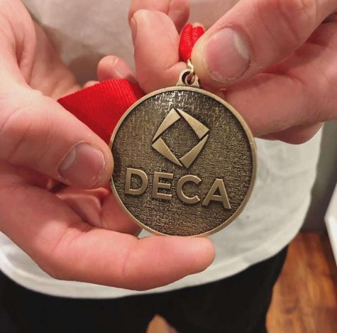 "Nothing but wins: Lake Stevens High School student Wesley Lawson displays his medal from Washington State DECA Area Competition. Many students from Lake Stevens High School placed in the top five for their given event. ""In order to win you have to literally be the best in your event, and you have to put in a lot of work and practice in order to be successful. When on stage and you can see how your hard work has paid off, knowing you are among the best, the feeling is unmatched,"" senior Wesley Lawson said."