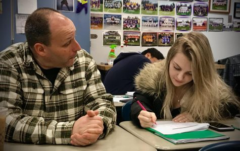 """Time to prep for finals! Mr. Flanders and senior Arielle Paris take time in class to catch up before finals week begins. Flex Period has also helped other schools and students prepare for finals without having time taken from class reviews. """"It would be great to have time to work with individuals during the school day other than our already assigned class periods,"""" said Mr. Flanders."""