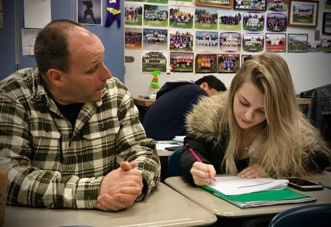 "Time to prep for finals! Mr. Flanders and senior Arielle Paris take time in class to catch up before finals week begins. Flex Period has also helped other schools and students prepare for finals without having time taken from class reviews. ""It would be great to have time to work with individuals during the school day other than our already assigned class periods,"" said Mr. Flanders."