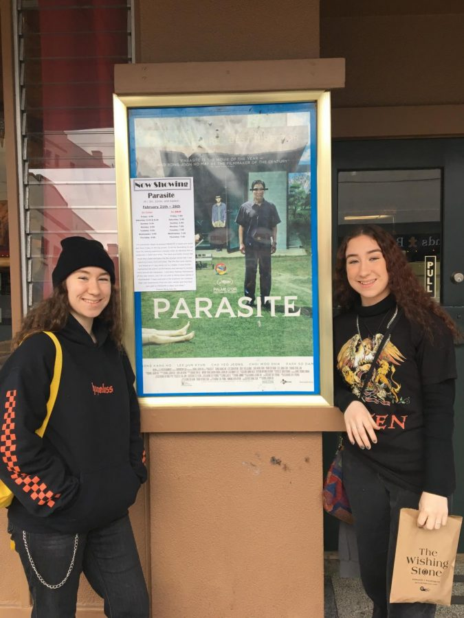 "Movie weekend! Juniors Emma and Ashley Brouqua stand in front of The Edmonds Theater and look forward to watching ""Parasite"" by director Bong Joon Ho. It became a hot topic in the film industry and attracts a lot of young viewers. ""This is a thriller of extraordinary cunning and emotional force. You will enjoy every second of it,"" Brouqua twins said."