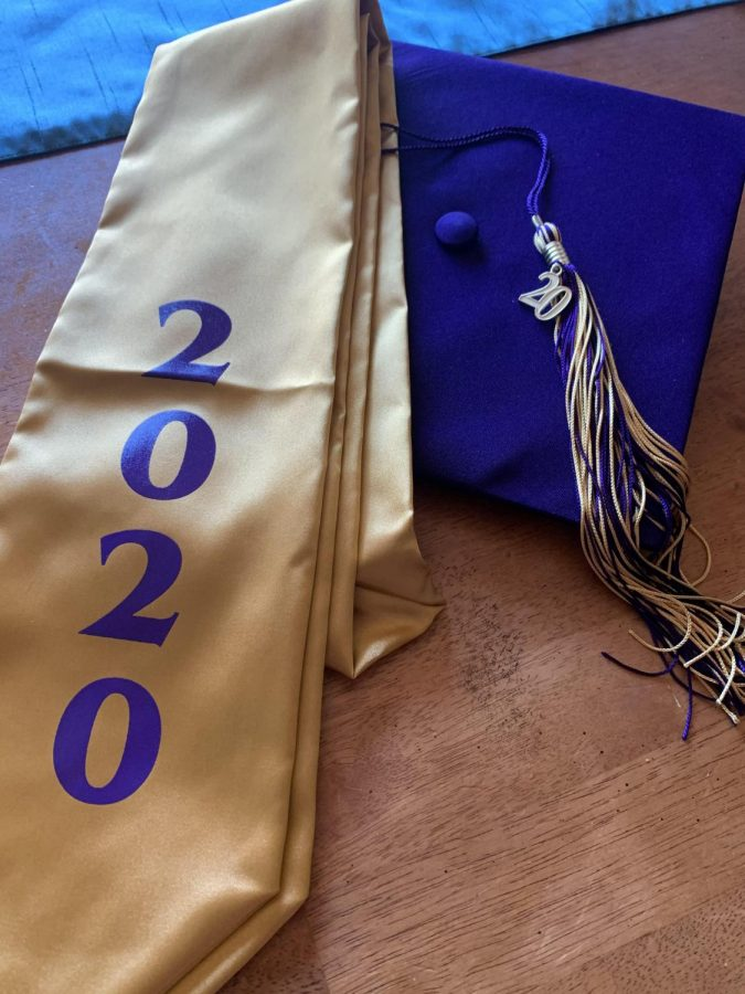 "Time's Arrow Marches Forward: Graduating Class of 2020 prepare their caps and gowns in preparation for the oncoming day in the spotlight as they get their diplomas and graduate. With everything going on and the stress of school making students want to shut down and give up, graduation day is a light at the end of the tunnel keeping students going. ""I worked my whole life towards getting my diploma, wearing that gown, and knowing I made it. I already started the race, I am going to finish it,"" senior Caleb Young said."