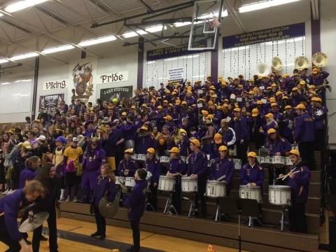 The LSHS pep band performs at a 2020 basketball game before the school