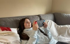 """Tranquil Gamer: Senior Brenda Call plays relaxing video games on her Nintendo Switch. She worked all day in distance learning and attended classes on google meet. """"I'm really grateful that I am able to relax after a stressful day of school work,"""" Call said."""