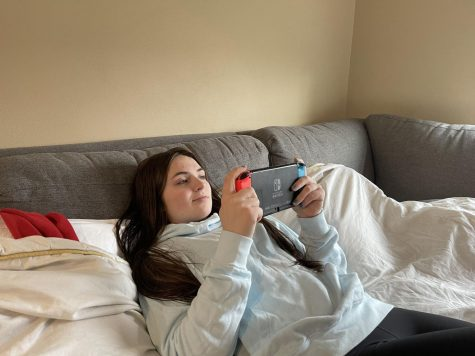 "Tranquil Gamer: Senior Brenda Call plays relaxing video games on her Nintendo Switch. She worked all day in distance learning and attended classes on google meet. ""I'm really grateful that I am able to relax after a stressful day of school work,"" Call said."