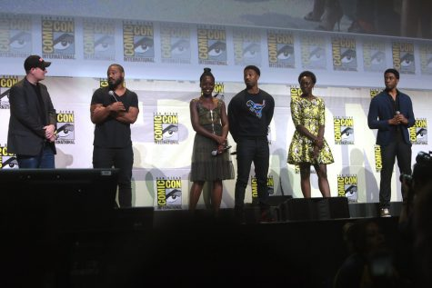 """Diversified Warriors: Marvel movie Black Panther's cast stands before a crowd at a Comic-Con convention in San Diego. Their movie left an unprecedented footprint on the issue of diversity in not only Marvel but the movie industry as a whole. """"Greater diversity in Marvel would make me more intrigued and interested in watching the movies. Since I am mixed with different races, it would be nice to see it in some of my favorite superhero movies,"""" senior Akilah Degrant said."""
