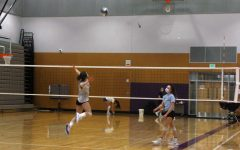 Spike: Lake Stevens High School girls volleyball team attacks the ball during practice. Even during Covid, they played strong in practice and in games. A junior, Coby Gundry witnessed how hard they were playing.