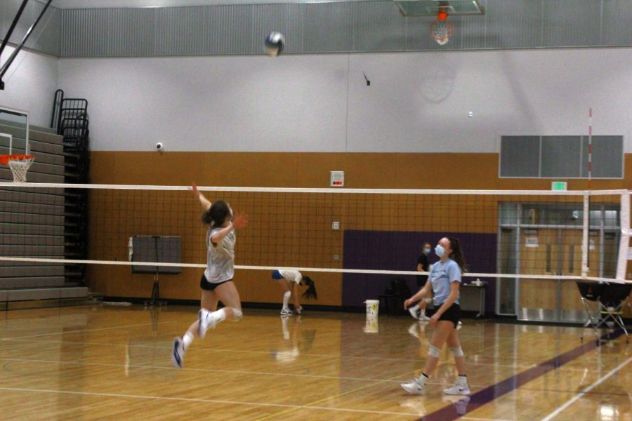 "Spike: Lake Stevens High School girls volleyball team attacks the ball during practice. Even during Covid, they played strong in practice and in games. A junior, Coby Gundry witnessed how hard they were playing. ""Yeah, they were playing pretty good,"" C. Gundry said."