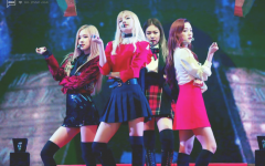"""The idols of Blackpink pose during one of their concerts. The singers (from left to right: Rosé, Jennie, Lisa, and Jisoo) are often judged online for their appearance and weight. """"These idols don't get to choose what they look like unless it's their day off, which is rare,"""" freshman Gabrielle Short said."""