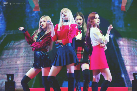 """The idols of Blackpink pose during one of their concerts. The singers (from left to right: Rosé, Jennie, Lisa, and Jisoo) are often judged online for their appearance and weight. """"These idols don"""