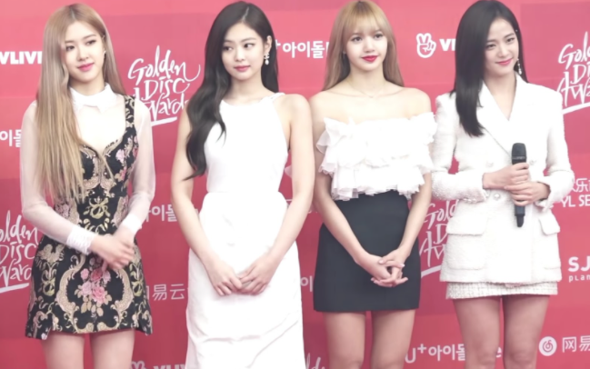 """The idols of BLACKPINK stand for pictures for the Golden Disks awards. The singers (from left to right: Rosé, Jennie, Lisa, and Jisoo) are often judged online for their appearance and weight. """"These idols don't get to choose what they look like unless it's their day off, which is rare,"""" freshman Gabrielle Short said."""