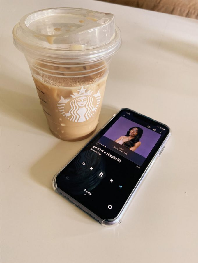 """Singing Siren: Starbucks drink and a phone displays Olivia Rodrigos third viral song, Good 4 U. These are two subjects that recently blew up on TikTok, bringing in millions of views. """"The most recent one I tried was a green tea matcha iced latte with brown sugar syrup and sweet cream cold foam... AND IT'S TO DIE FOR,"""" senior Hope Ferguson said."""